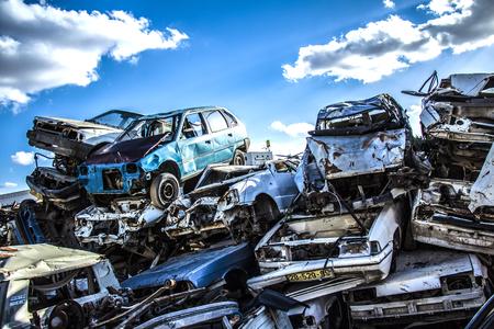 ゴミ捨て場に捨てられた車 写真素材