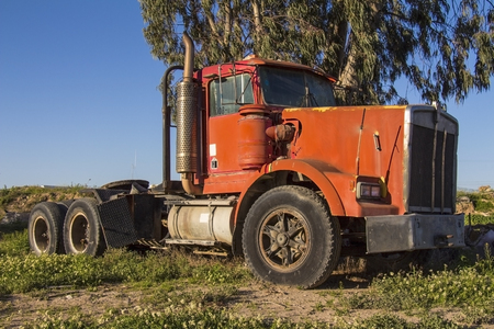 scrapyard: Abandoned retro truck on junkyard