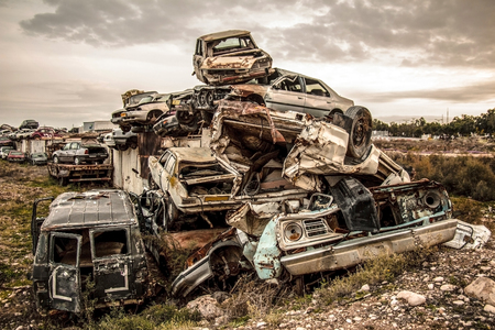 Pile of discarded cars on junkyard