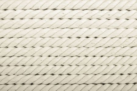 Heavy, white coiled rope. Stock Photo