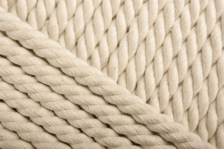 bonding rope: Heavy, white coiled rope. Stock Photo