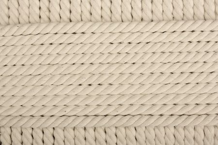 coiled rope: Heavy, white coiled rope. Stock Photo