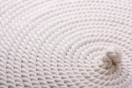 bonding rope: Heavy, white coiled rope. Stock Photo