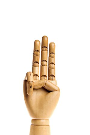 Wooden, human hand isolated on a white background photo