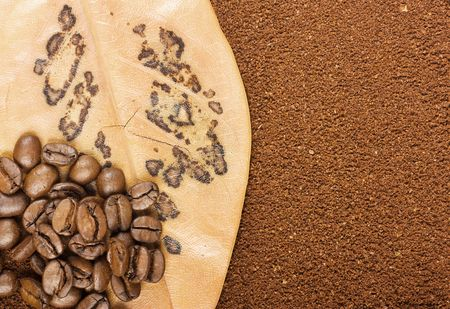 Coffee grains on leaf, ground coffee be use as background Stock Photo