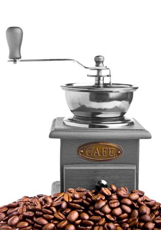 caf: Coffee grinder and coffee beans around it