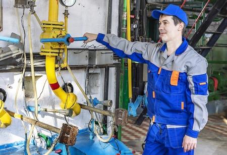 An experienced operator service gas boiler equipment. Reklamní fotografie
