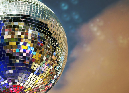 Shiny mirror ball with colorful highlights at the disco.