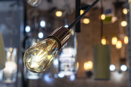 Light bulb with dark glass in loft style. 스톡 콘텐츠