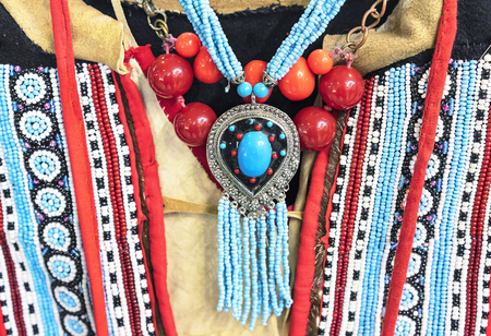 Pendant with turquoise and beadwork at the small peoples of the north of Siberia in Russia.