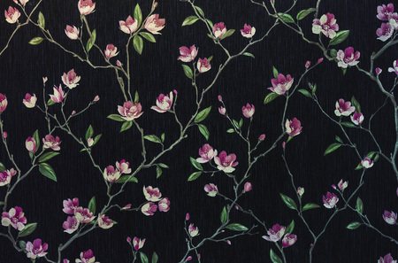 Fragment of a decorative panel with a floral pattern. Floral background for design and decoration. Flowers on a black background.