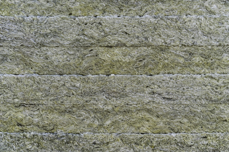 Thermal insulation material, rock wool. Thermal roof insulation layer. Mineral wool or mineral fiber, mineral cotton, mineral fibre, glass wool, MMMF, MMVF. Fiber thermal insulation close-up. Imagens