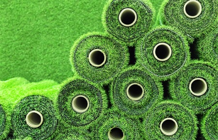 Artificial grass in rolls to cover tennis courts, sports fields, golf courses and football.