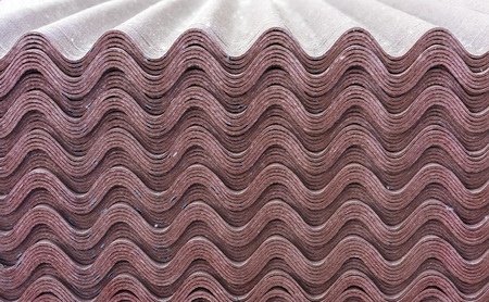 Sheets of brown ondulin. Slate to cover the roof of the house. Background from ondulin. Stok Fotoğraf