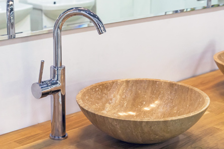 Water-supply faucet mixer and sink of natural stone. Reklamní fotografie