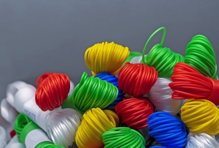 Colored plastic rope. Multicolored plastic wires in bundles.