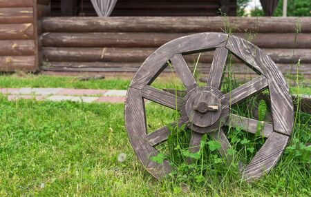 Old wooden cartwheel. Wheel from the old horse-drawn cart.