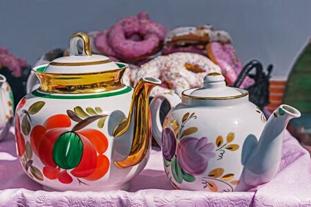 Ceramic teapots for brewing tea on the background of sweeties. Stok Fotoğraf