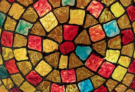 Stained glass mosaic on the lampshade of the chandelier.