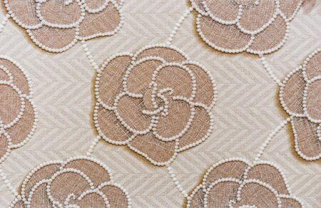 Beige porcelan stoneware tile with floral pattern. Background of porcelain stonewear tiles.