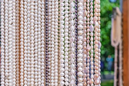 Pearl beads. Round river pearls. Pearl background.