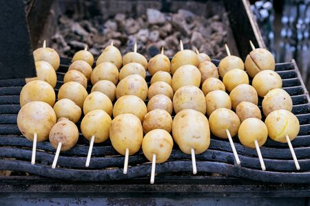Potatoes on sticks for grill. Barbecue of potatoes. Stock fotó