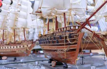 Model of an old sailing ship in a showcase of a gift shop.