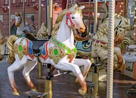 Horse in the vintage style on a childrens carousel. Stock Photo