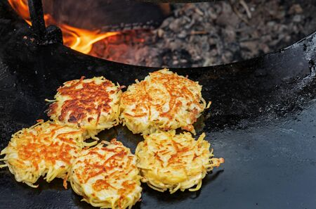 Grilled potato pancakes. Vegetarian dish of grated and fried potatoes.