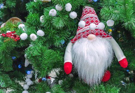 Santa Claus in a woolen knitted hat with a Scandinavian pattern. Zdjęcie Seryjne