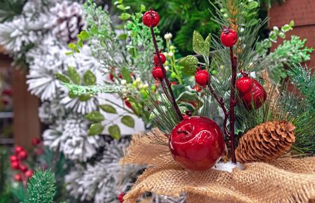 Christmas decorations red apple, pine cone and twig with red berries.
