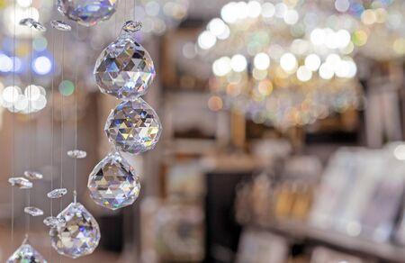 Hanging crystal balls in a modern chandelier. Zdjęcie Seryjne