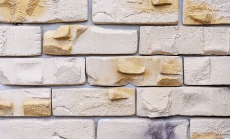 Brick wall of beige bricks. Background and texture of brickwork.