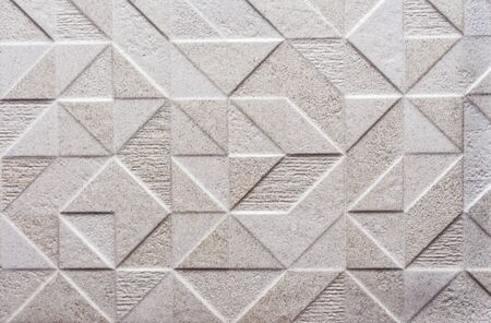 White embossed porcelain stoneware. Background and texture of porcelain tiles. Archivio Fotografico