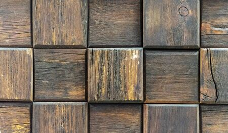 Cubes from of dark aged wood. Panel with wooden squares for wall decor.