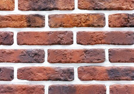 Decorative brick wall from of brown bricks. Background and texture of brickwork.