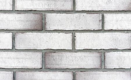 Brick wall from of white bricks. Background and texture of brickwork.