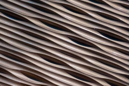 Brown plastic panel with a wavy texture. Brown background for design and decoration.
