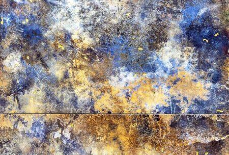 Porcelain tiles with blue, yellow and white spots. Background and texture of colored porcelain stoneware.