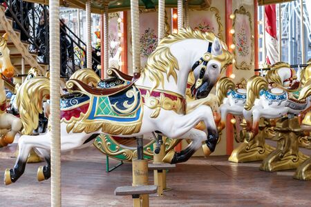 Horse in vintage style on a children's circular carousel.