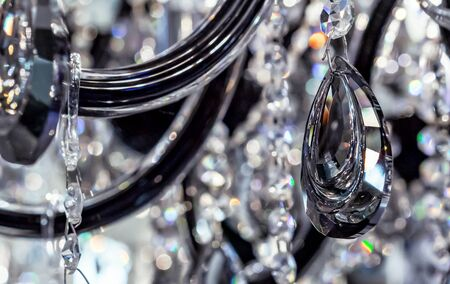 Black crystal pendants on a classic chandelier.