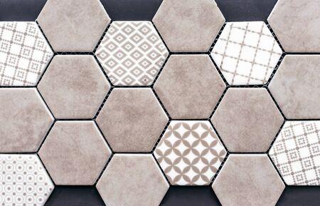 Beige ceramic tile in the form of honeycombs. Hexagonal floor tiles.