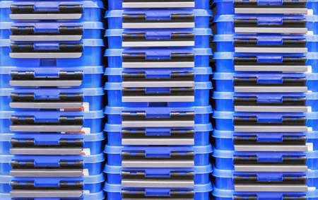 Dark blue plastic boxes for storing household items.