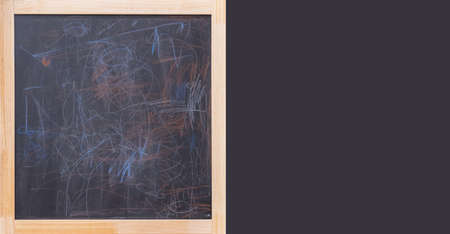 Black chalk board with multicolored strokes in a wooden frame.