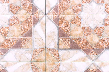 Porcelain stoneware with brown ornament. Texture of colored porcelain tile.