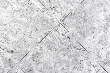 Gray porcelain stoneware tiles. Background and texture of porcelain stoneware.