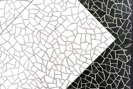 Black and white porcelain stoneware with a cracking effect.
