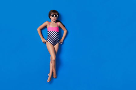 child bikini summer top,on a colorful blue background.