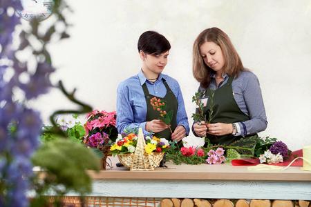 Small flower business. Women working in flower shop.