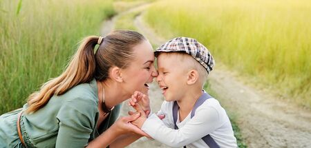 Woman and child. Mom and son laughing,touching face to face. Mother and little boy together smiling. Foto de archivo